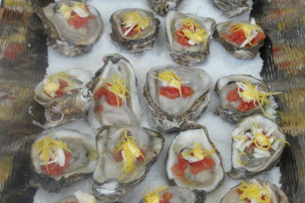 North Atlantic Oysters with Roma Tomato Caviar, Fresh Horseradish, Tobasco, Aioli, Myer Lemon